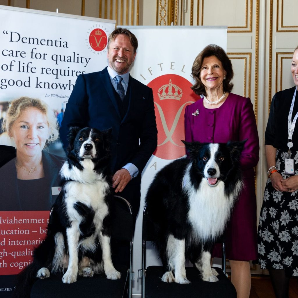 Queen Silvia with people and dogs